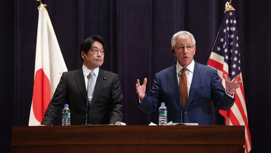 U.S. Secretary of Defense Chuck Hagel and Japanese Defense Minister Itsunori Onodera participate in a joint news conference at the Japanese Ministry of Defense headquarters Sunday April 6, 2014 in Tokyo, Japan. Secretary Hagel announced that the U.S. is planning to forward-deploy two additional AEGIS ballistic missile defense ships to Japan by 2017.  (AP Photo/Alex Wong/POOL)
