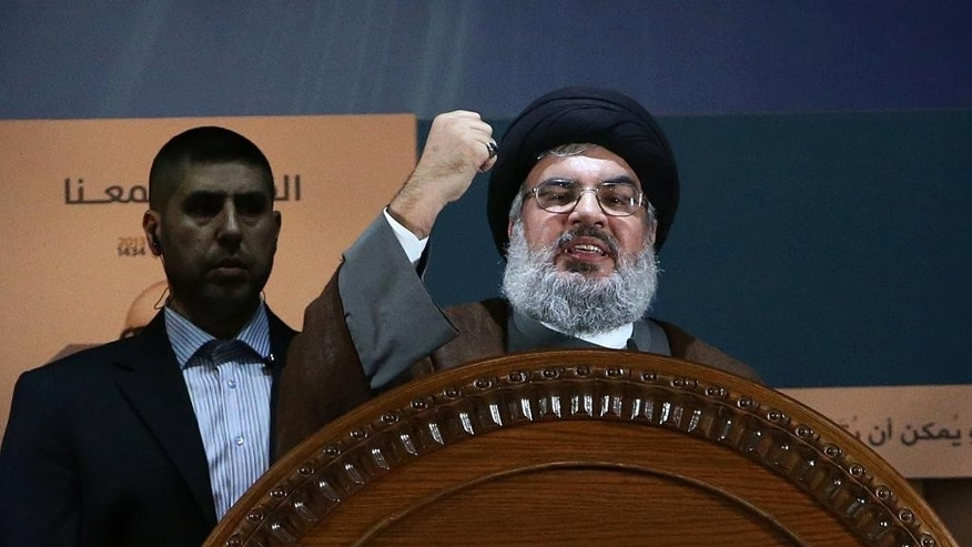 FILE - In this August 2, 2013, file photo, Hezbollah leader Sheik Hassan Nasrallah speaks during a rally to mark Jerusalem day, or Al-Quds day, in the southern suburb of Beirut, Lebanon. The government of Syrian President Bashar Assad is no longer in danger of falling, Nasrallah, the leader of Lebanon's militant Hezbollah group, said in interview with Lebanon's daily As-Safir newspaper published Sunday, April 6, 2014. (AP Photo/Hussein Malla, File)