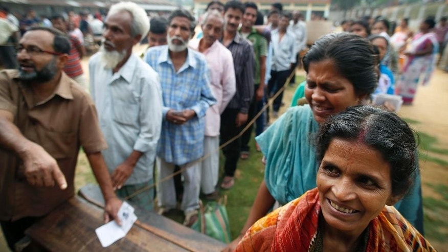 People stand in line to cast their votes during the first phase of elections in Agartala, in the northeastern Indian state of Tripura, India, Monday, April 7, 2014.  The Indian national elections will be held over several weeks in phases to ensure safe and fair elections. (AP Photo/Saurabh Das)