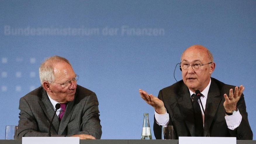 German Finance Minister Wolfgang Schaeuble, left, and his new counterpart from France Michel Sapin brief the media during a meeting at the Finance Ministry in Berlin, Monday, April 7, 2014. (AP Photo/Markus Schreiber)