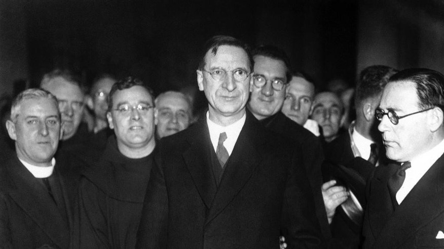 FILE - In this March 3, 1939, file photo Eamon De Valera, centre, the Premier of Eire, arrives in Rome to attend the Coronation of Pope Pius XII in St. Peter's, Rome. Relations between Britain and Ireland have experienced many highs and lows in a century marked by rebellion, terror and treaties. (AP Photo, File)