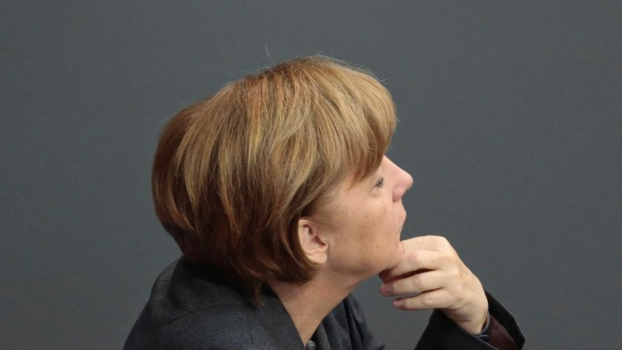 German Chancellor Angela Merkel attends the first day of the debate on the German budget for 2014 in Berlin, Germany, Tuesday, April 8, 2014. During a four-day debate the German parliament will discuss the budget plans for the running year. (AP Photo/Markus Schreiber)