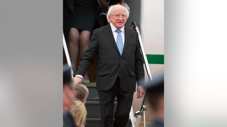 The President of Ireland, Michael D Higgins arrives at London Heathrow Airport for the first state visit by a President of Ireland to the United Kingdom, Monday April 7, 2014. This state visit by Higgins has been decades in the making and provides a poignant milestone for peacemaking between Ireland and UK following many years of conflict and division. (AP Photo / Steve Parsons, PA) UNITED KINGDOM OUT - NO SALES - NO ARCHIVES