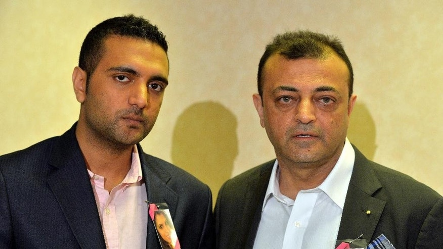 "Asok Hindocha, right, the uncle of Anni Dewani and Anish Hindocha, the brother of Anni Dewani speak at a press conference in central London, Monday, April 7, 2014. Anni Dewani was found shot dead in an abandoned taxi in Cape Town's Gugulethu township in November 2010. Her husband Shrien Dewani has spent years fighting extradition over the death of his 28-year-old bride, lawyers for the 34-year-old businessman say he suffers from post-traumatic stress and depression and is unfit to stand trial. But last month Britain's High Court rejected his grounds for appeal. He is expected to be put on a flight to Cape Town Monday, and South African officials say he will appear in court there Tuesday. The Anni Dewani's brother, Anish Hindocha, said the extradition brought them ""one step closer"" to justice. (AP Photo/John Stillwell, PA Wire)    UNITED KINGDOM OUT    -   NO SALES   -    NO ARCHIVES"
