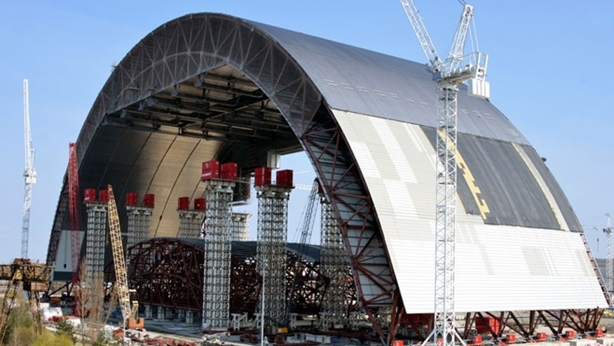 The first half of the arch has already been completed and sits in a waiting position near reactor four until the second half is finished.