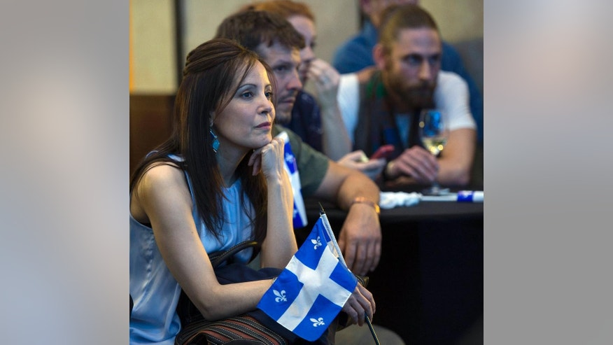 Parti Quebecois supporters listen to election results at the party's election headquarters Monday, April 7, 2014 in Montreal. (AP Photo/The Canadian Press, Paul Chiasson)