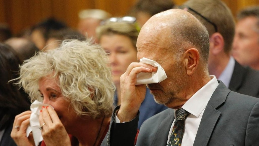 Family members of Oscar Pistorius, including uncle Arnold Pistorius, right, cry as they listen to Oscar Pistorius testifying in court in Pretoria, South Africa, Tuesday, April 8, 2014. Pistorius is charged with the murder of his girlfriend Reeva Steenkamp, on Valentines Day 2013. (AP Photo/Kim Ludbrook, Pool)