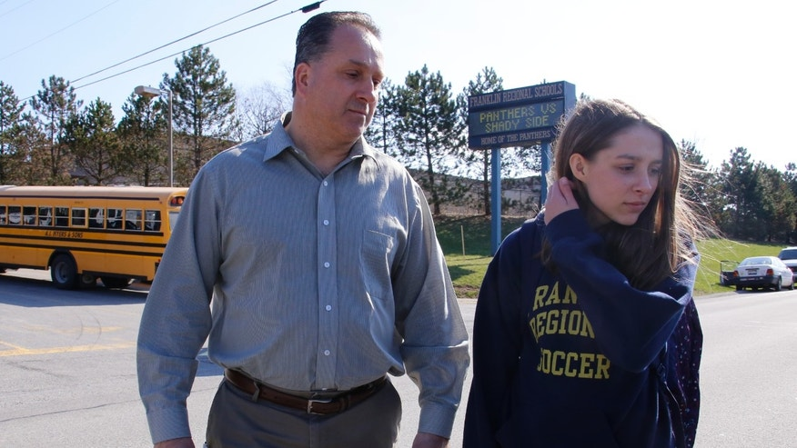 Jenna Mickel, a sophomore at Franklin Regional High School, with her father, Richard, April 9, 2014, in Murrysville, Pa.