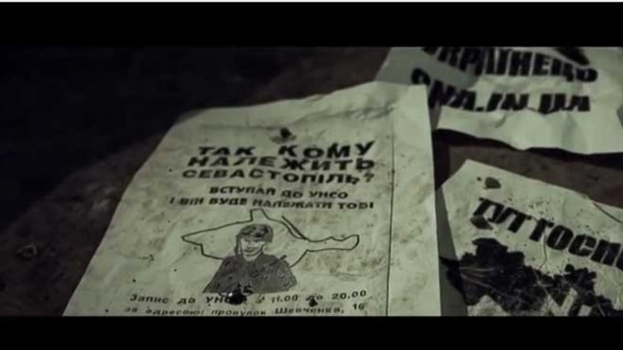 The YouTube video shows leaflets depicting a takeover of Russia by right-wing Ukrainian extremists.