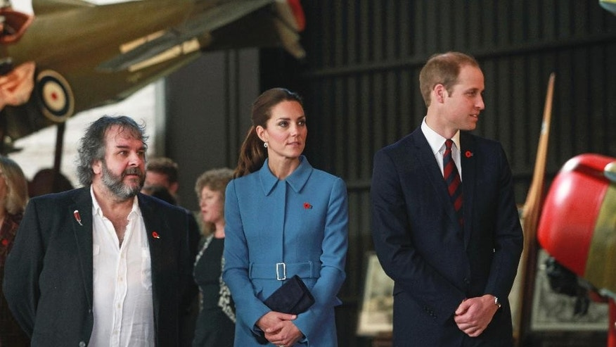 April 10, 2014: Britain's Prince William, right, and his Kate, the Duchess of Cambridge, are guided on a tour of the Omaka Aviation Heritage Centre by film director Peter Jackson, in Blenheim, New Zealand.
