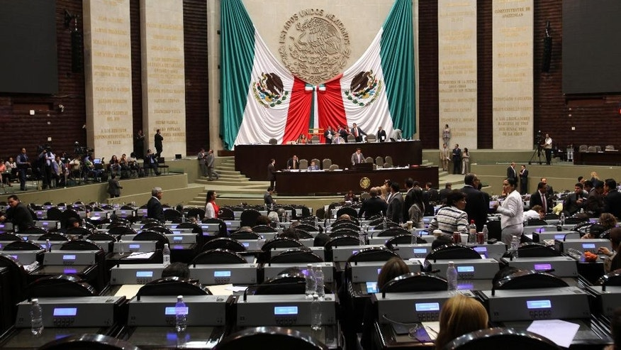 Lawmakers hold a session at Mexico's national Congress in Mexico City, Wednesday, April 9, 2014. Over the decades, corruption scandals have tainted presidents, brought down mayors, seen generals jailed and led to charges against untold numbers of police. But Congress has remained largely untouched. Now, that perception has changed, leaving Mexicans wondering if there is any institution in the country left untouched by corruption. (AP Photo/Marco Ugarte)