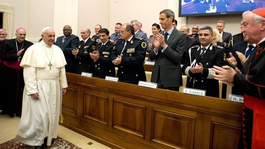 April 10, 2014: In this photo released by Vatican newspaper L'Osservatore Romano Pope Francis arrives at a conference about the human trafficking,  at the Vatican.