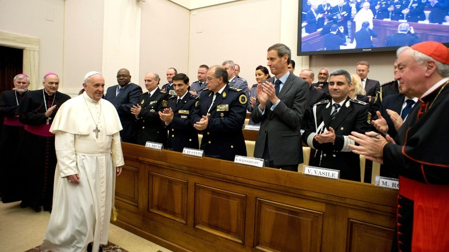 Pope Francis arrives at a conference about the human trafficking,  at the Vatican, Thursday, April 10, 2014.