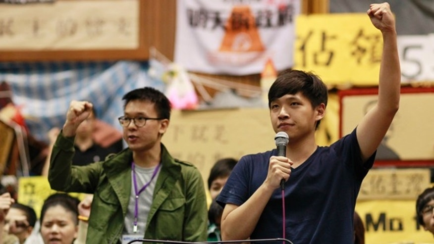 April 7, 2014: Lin Fei-fan, left, and Chen Wei-ting, leaders of the student protests against a trade pact with China, speak to the media during a press conference on the occupied legislature floor in Taipei, Taiwan.