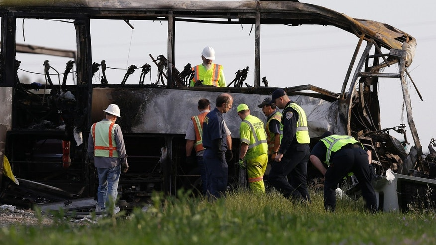 Remains of a tour bus that was struck by a FedEx truck on Interstate 5 in Orland, Calif., Friday, April 11, 2014.