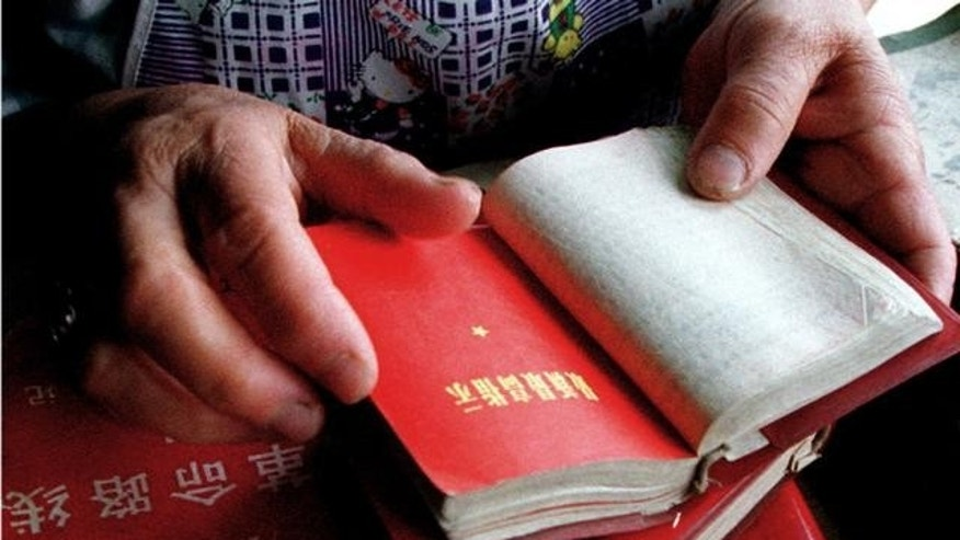 "Undated FILE photo of hands holding Chairman Mao's ""Little Red Book"", Beijing, China."