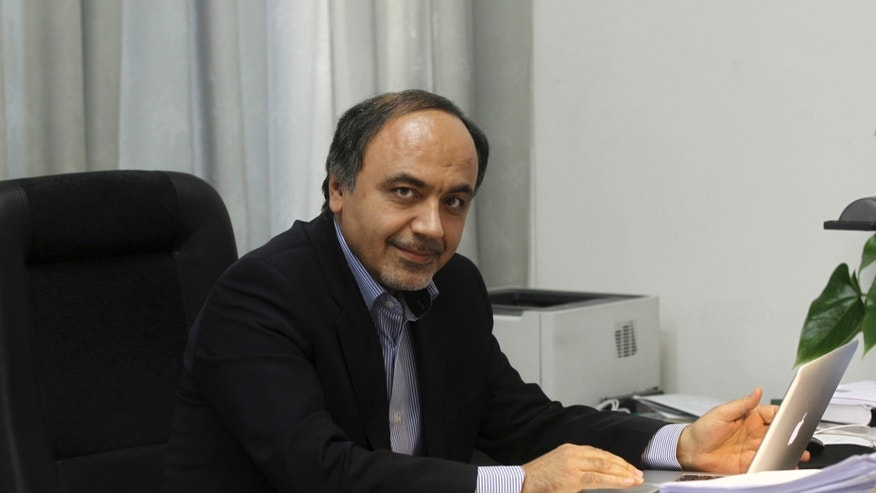 April, 12, 2014: In this undated photo provided by the office of the Iranian President, Hamid Aboutalebi, an Iranian diplomat, who was recently named  as Iran's ambassador at the United Nations, sits in his office in Tehran, Iran.