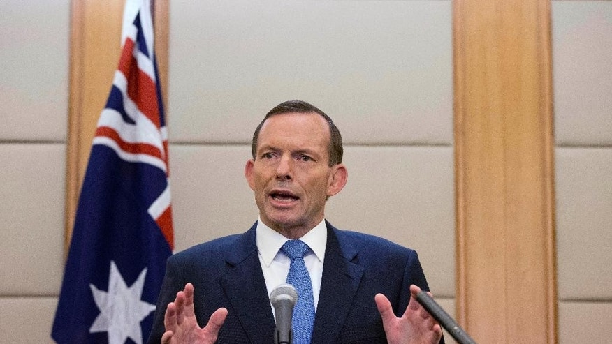 Australian Prime Minister Tony Abbott speaks during a press conference at a hotel in Beijing, China Saturday, April 12, 2014. Abbott told Chinese President Xi Jinping during their meeting on Friday that he was confident signals heard by an Australian ship towing a U.S. Navy device that detects flight recorder pings are coming from the missing Malaysian Airlines Flight 370. Officials believe the plane flew off course for an unknown reason and went down in the southern Indian Ocean off the west coast of Australia. (AP Photo/Andy Wong)