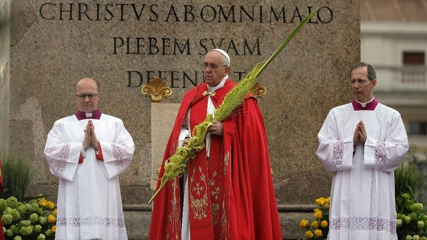 Pope Francis, center, celebrates a Palm Sunday mass in St. Peter's Square, at the Vatican, Sunday, April 13, 2014. (AP Photo/Gregorio Borgia)