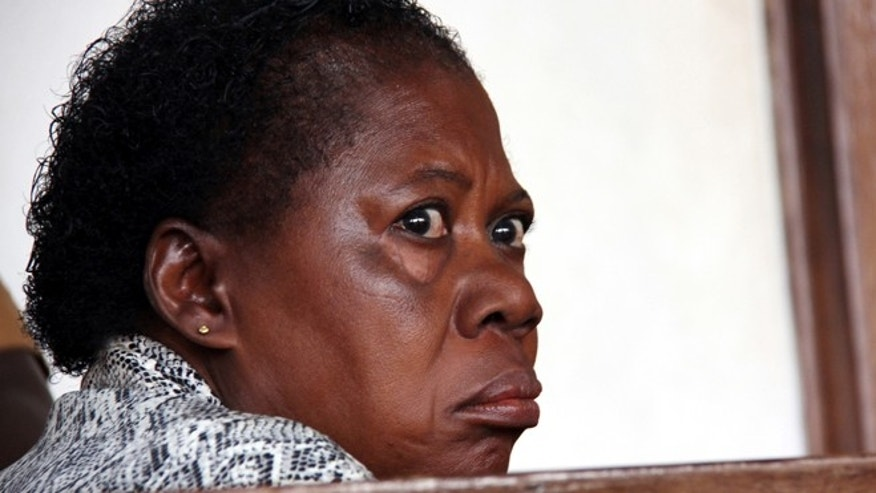 March 20, 2014: A Ugandan nurse, Rosemary Namubiru, sits in court in the capital Kampala, Uganda.