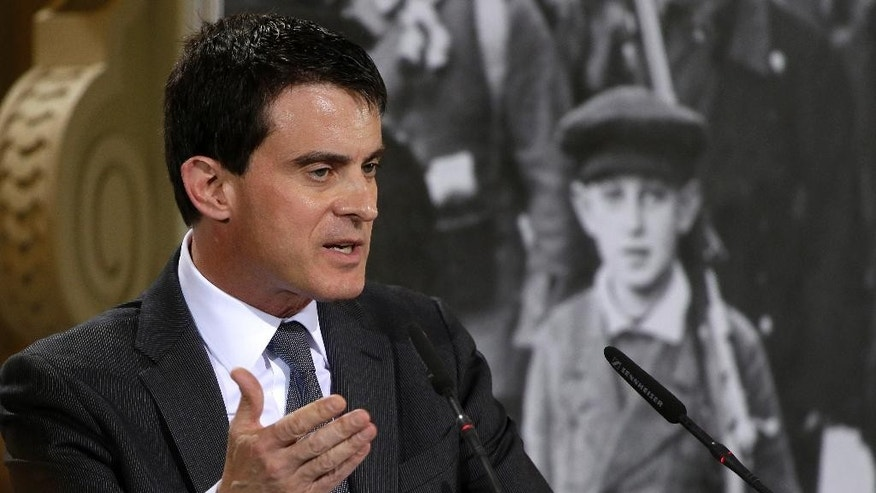 Prime Minister of France Manuel Valls delivers a speech during a 100 Years World War I remembrance event of the German Social Democratic Party, SPD, in Berlin, Germany, Monday, April 14, 2014. (AP Photo/Michael Sohn)