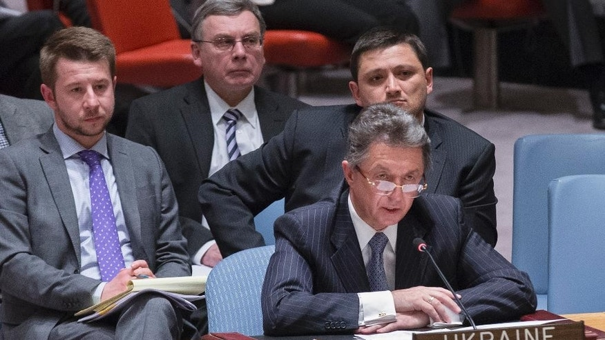 Yuriy Sergeyev, Ukraine's ambassador to the United Nations, speaks during an U.N. Security Council emergency meeting called at Russia's request to discuss the growing crisis in Ukraine, Sunday, April 13, 2014, at United Nations headquarters. The meeting comes as the new Ukrainian government declared it would deploy armed forces to quash an increasingly bold pro-Russian insurgency in its eastern region. (AP Photo/John Minchillo)