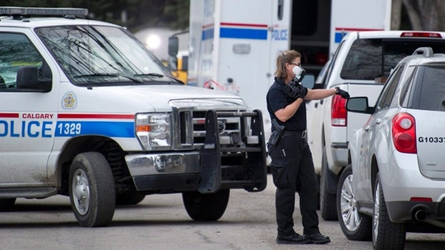 Apr. 15, 2014: Police investigate the scene of a multiple fatal stabbing in northwest Calgary, Alberta.