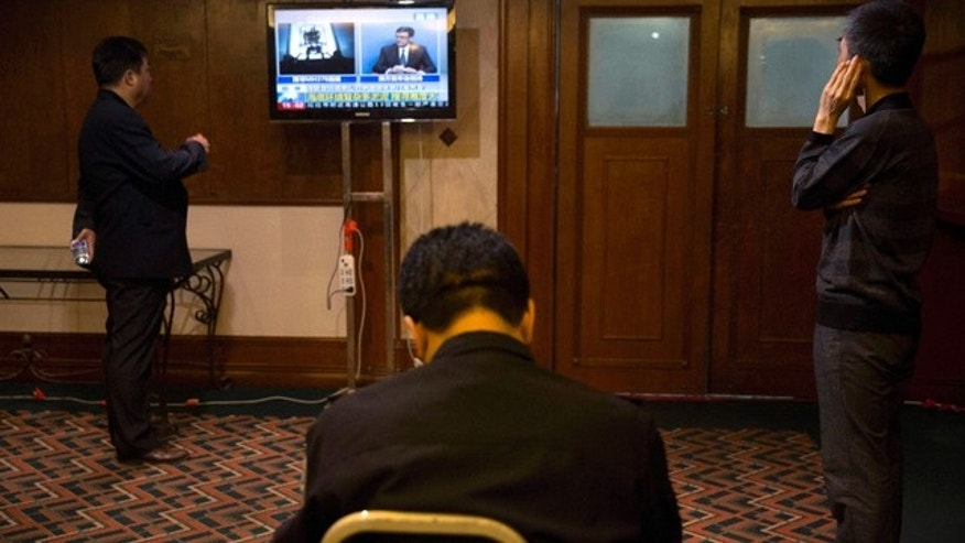 April 14, 2014: Relatives of Chinese passengers on board missing Malaysia Airlines Flight MH370 watch a live broadcast of a press conference by Angus Houston, the head of a joint agency coordinating the search off Australia's west coast, at a room reserved for family members in Beijing, China. (AP Photo/Ng Han Guan)