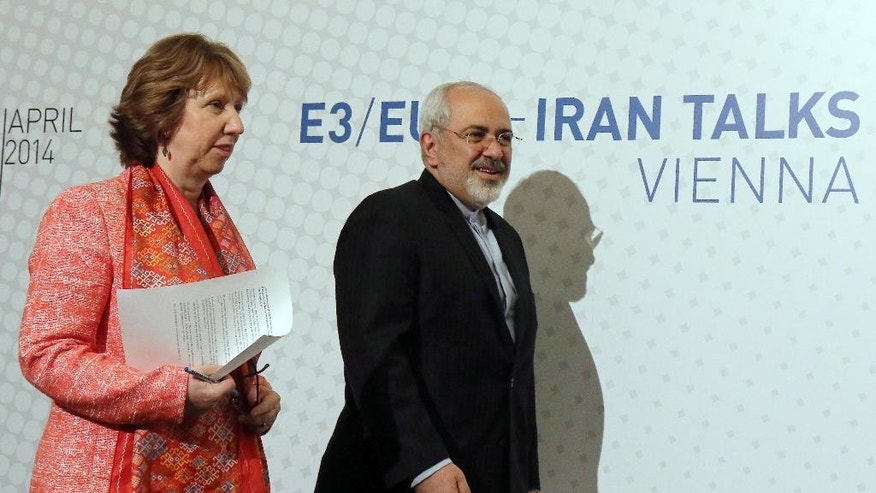 European foreign policy chief Catherine Ashton and Iranian Foreign Minister Mohamad Javad Zarif, from left, arrive to address the media after closed-door nuclear talks in Vienna, Austria, Wednesday, April 9, 2014. (AP Photo/Ronald Zak)
