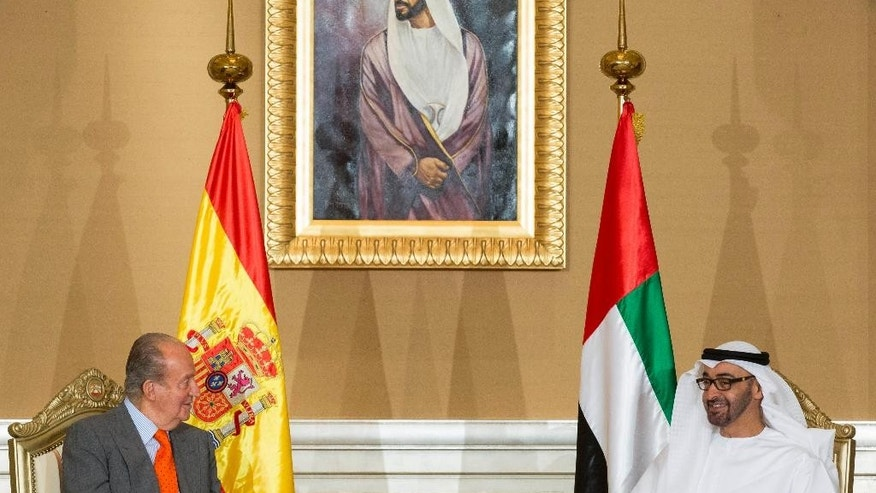 In this image released by the Emirates News Agency, WAM, Sheikh Mohamed bin Zayed Al Nahyan, Crown Prince of Abu Dhabi and Deputy Supreme Commander of the UAE Armed Forces, right, talks with Juan Carlos, King of Spain on the sidelines of the UAE - Spain Economic Forum. (AP Photo/Ryan Carter - Crown Prince Court - Abu Dhabi )