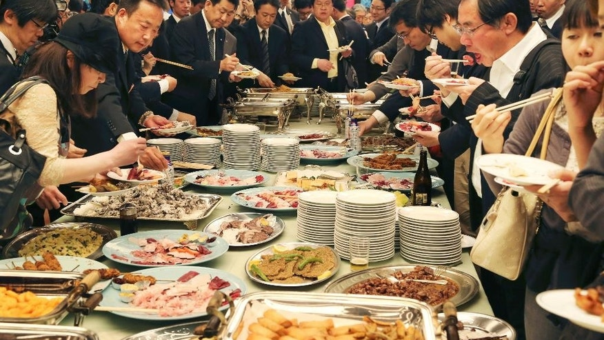 April 15, 2014: Supporters of Japan's whaling eat whale meat dishes during the 26th whale meat tasting event in Tokyo.