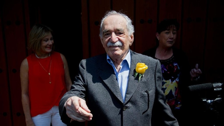 "FILE - In this March 6, 2014, file photo, Colombian Nobel Literature laureate Gabriel Garcia Marquez greets fans and reporters outside his home on his birthday in Mexico City. The family of says Nobel laureate Gabriel Garcia Marquez says his health is ""very fragile"" after he left a Mexico City hospital on April 8. Garcia Marquez is at his home in Mexico City after eight days in the hospital last week for treatment of pneumonia and related problems. (AP Photo/Eduardo Verdugo, File)"