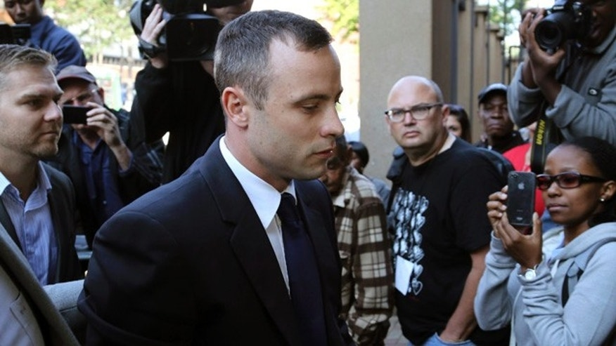 April 15, 2014: Oscar Pistorius arrives at the high court in Pretoria, South Africa. (AP Photo/Themba Hadebe)