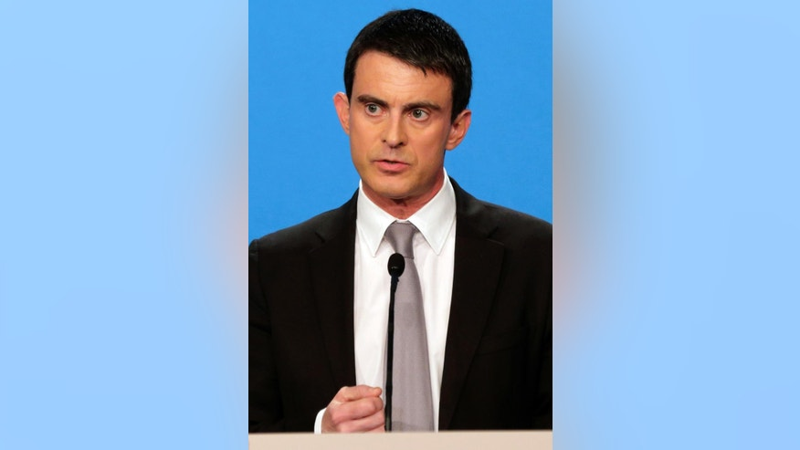 French Prime Minister Manuel Valls delivers a statement after the weekly cabinet meeting at the Elysee Palace in Paris, Wednesday, April 16, 2014.  Valls provided details of the government's plan to reduce public spending by 50 billion euros ($ 69 billion) and reiterated that France would honor its European commitments on deficit reduction.  (AP Photo/Philippe Wojazer, Pool)