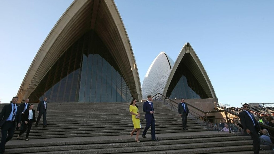 Britain's Prince William, center right, and his wife, Kate, the Duchess of Cambridge, center left, walk down the steps at the Sydney Opera House following a reception after their arrival in Sydney, Wednesday, April 16, 2014. The royal couple, along with their son Prince George, are on a 10-day official visit. (AP Photo/Rick Rycroft)