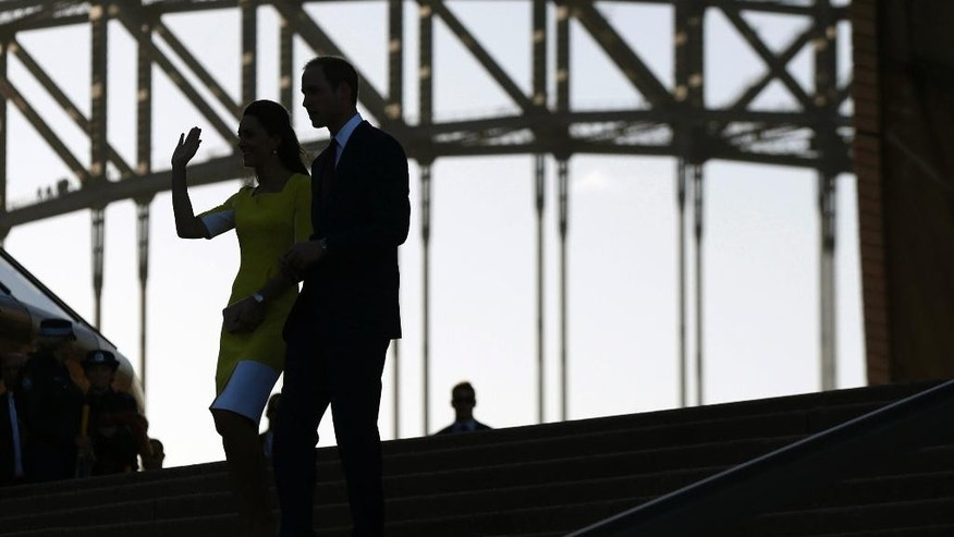 Britain's Prince William, right, and his wife Kate, the Duchess of Cambridge, walk down the steps of the Sydney Opera House following a reception in Sydney, Australia, Wednesday, April 16, 2014. The royal couple, along with their son Prince George, are on a 10-day official visit. (AP Photo/Jason Reed, Pool)