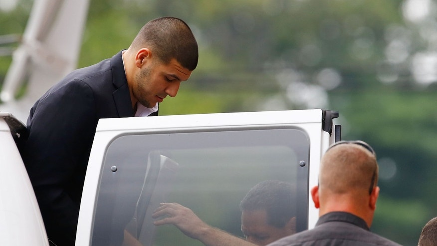 Aaron Hernandez is escorted into Attleboro District Court on August 22, 2013 in North Attleboro, Massachusetts.