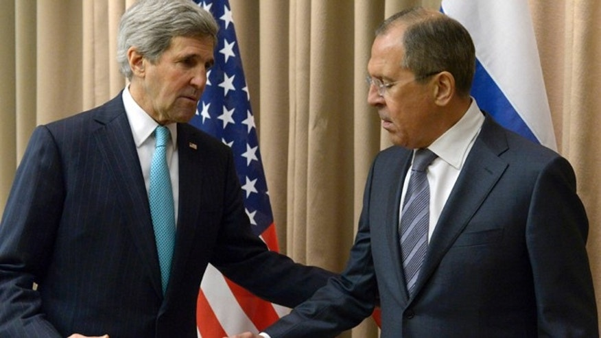 April 17, 2014: U.S. Secretary of State John Kerry, left, shakes hands with Russian Foreign Minister Sergey Lavrov before a bilateral meeting to discuss the ongoing situation in Ukraine as diplomats from the U.S., Ukraine, Russia and the European Union gather for discussions in Geneva.