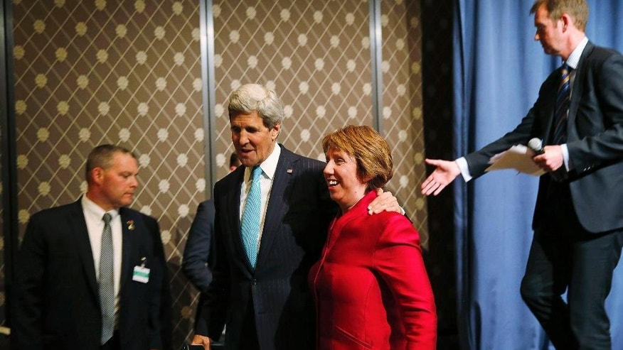 Secretary of State John Kerry and European Union High Representative Catherine Ashton, leave the stage after  speaking to the media after attending a quadrilateral meeting between representatives of the US, Ukraine, Russia and the European Union about the ongoing situation in Ukraine, Thursday, April 17, 2014, in Geneva. Top diplomats from the US, European Union, Russia and Ukraine reached agreement after marathon talks Thursday on immediate steps to ease the crisis in Ukraine.  (AP Photo/Jim Bourg, Pool)