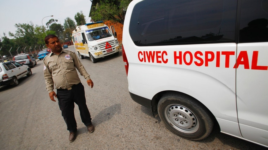 April 18, 2014 - Ambulances are seen waiting outside the Domestic Airport, waiting for injured people of avalanche to arrive, in Katmandu, Nepal. An avalanche swept down a climbing route on Mount Everest early Friday, killing at least 12 Nepalese guides and leaving 4 missing in the deadliest disaster on the world's highest peak.