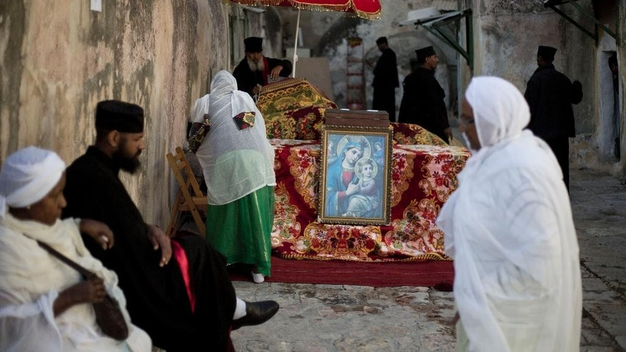 Ethiopian Orthodox Christians gather at Deir El Sultan at the start of the Washing of the Feet ceremony outside the Church of the Holy Sepulcher, traditionally believed by many to be the site of the crucifixion and burial of Jesus Christ, Jerusalem,Thursday, April 17, 2014. Orthodox Christians from around the world are in the Holy Land marking the solemn period of Easter. (AP Photo/Ariel Schalit)