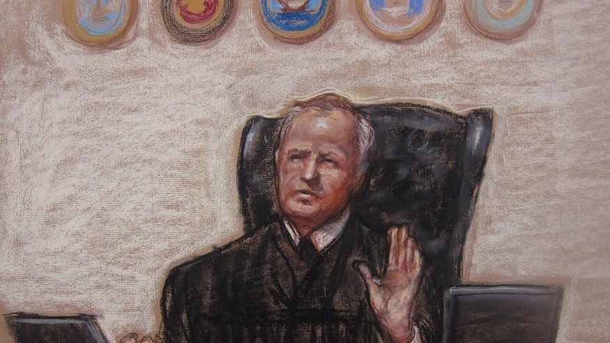 In this Pentagon-approved sketch by court artist Janet Hamlin, Judge, Army Col. James Pohl halts the Sept. 11 pretrial hearing at the Guantanamo Bay U.S. Naval Base in Cuba, Thursday April 17, 2014. An effort to prosecute the self-proclaimed mastermind of the Sept. 11 terrorist attack and four co-defendants veered off track again as a pretrial hearing ended with new obstacles that threaten to further derail the case before a military tribunal at Guantanamo Bay. (AP Photo/Janet Hamlin, Pool)