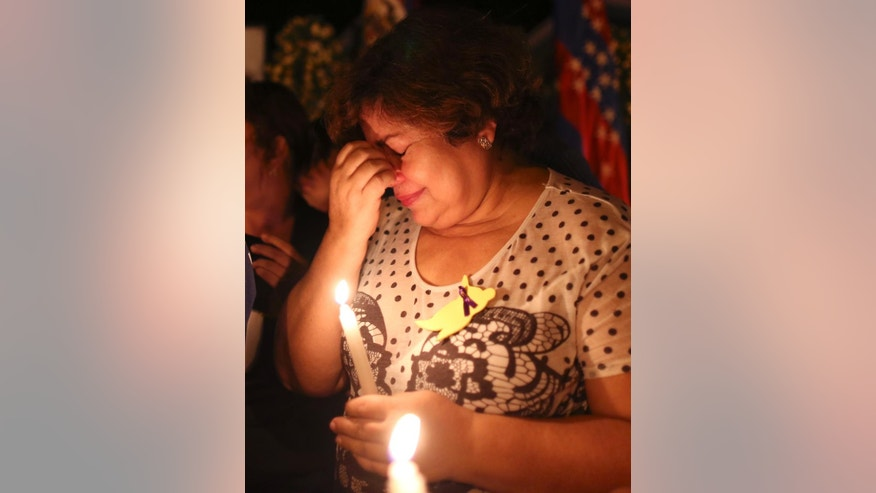 Graciela Fernandez, mourns during a vigil in front of the Gabriel Garcia Marquez Museum, at the house were he was born in Aracataca, Colombia, Thursday, April 17, 2014. Garcia Marquez, who was was among Latin America's most popular writers, died in Mexico City at the age of 87. (AP Photo/Ricardo Mazalan)