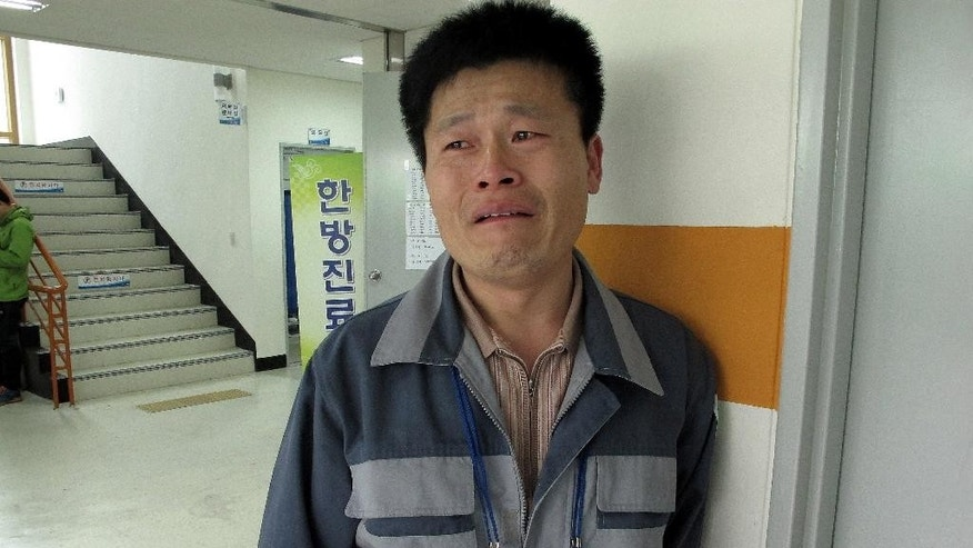 Lee Byung-soo, 47, the father of Lee Seok-joon, 15, one of missing passengers aboard the sunken ferry Sewol, cries during an interview at a gymnasium in Jindo, South Korea Saturday, April 19, 2014. Relatives of about 270 people missing have grown increasingly exasperated and distrusting of South Korean authorities, in part because of confusion, early missteps and perceived foot-dragging. For days, they have dealt with shock, fear and bewilderment. They have briefly been buoyed by new ideas for finding survivors, changes in death counts and the number of missing, even rumors of contact with trapped relatives, only to be let down later. (AP Photo/Gillian Wong)