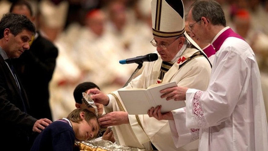 Apr. 19, 2014: Pope Francis baptizes 10-year-hold Giorgio Capezzuoli during the Easter vigil service in St. Peter's Basilica, at the Vatican
