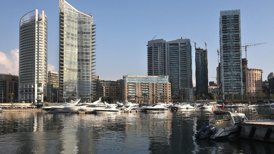 In this April 10, 2014 photo, luxury high-rise buildings line the seafront, in Beirut  Lebanon. One by one, the old traditional houses of Beirut are vanishing as luxury towers sprout up on every corner, altering the city's skyline almost beyond recognition. While Lebanon's real estate sector has developed to become one of the country's success stories, many say it is coming at the expense of Lebanon's identity and heritage. (AP Photo/Hussein Malla)