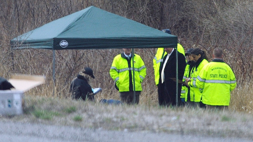 Massachusetts State Police stand along Interstate 190 where police found the body of  5-year-old Jeremiah Oliver, who was reported missing in December.