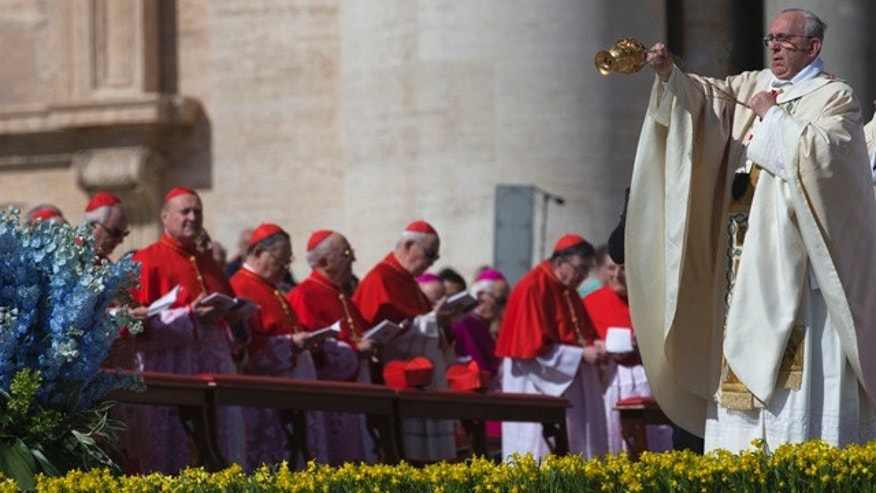 April 20, 2014: Pope Francis blesses the faithful with incense as he arrives to celebrate Easter Sunday Mass in St. Peter's Square at the Vatican. (AP Photo/Andrew Medichini)