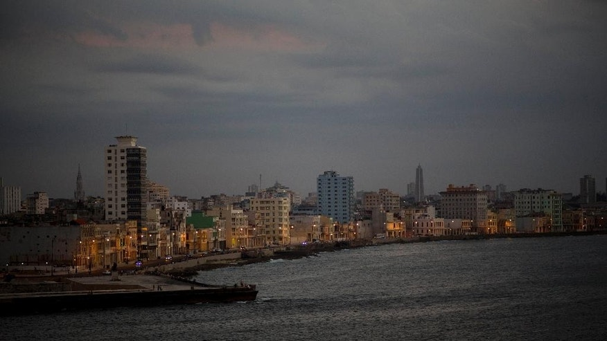Buildings line the waterfront esplanade known as the Malecon as seen from the Morro Castle in Havana, Cuba.