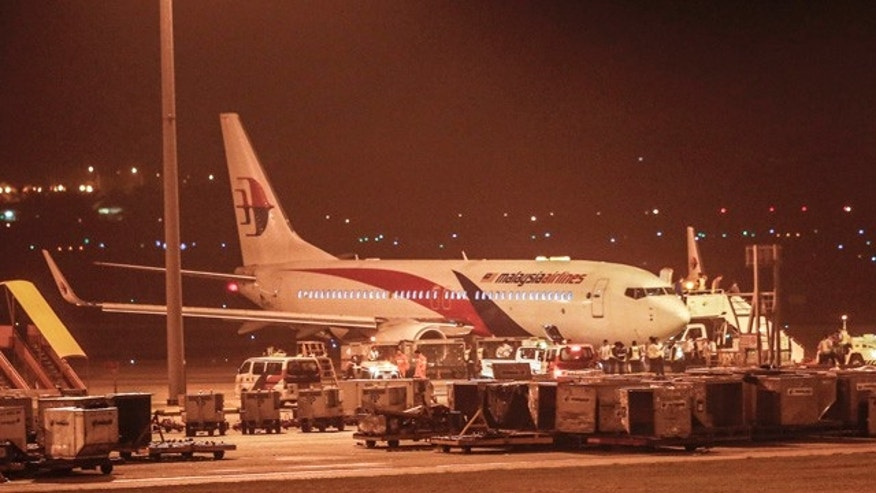 April 21, 2014: Malaysia Airlines flight MH192 bound for Bangalore turned back toward and parked at Kuala Lumpur International Airport in Sepang, Malaysia after its right landing gear malfunctioned upon takeoff. The airline says Flight 192 carrying 166 people landed safely at the Kuala Lumpur International Airport early Monday, four hours after it departed. (AP Photo/Vincent Thian)
